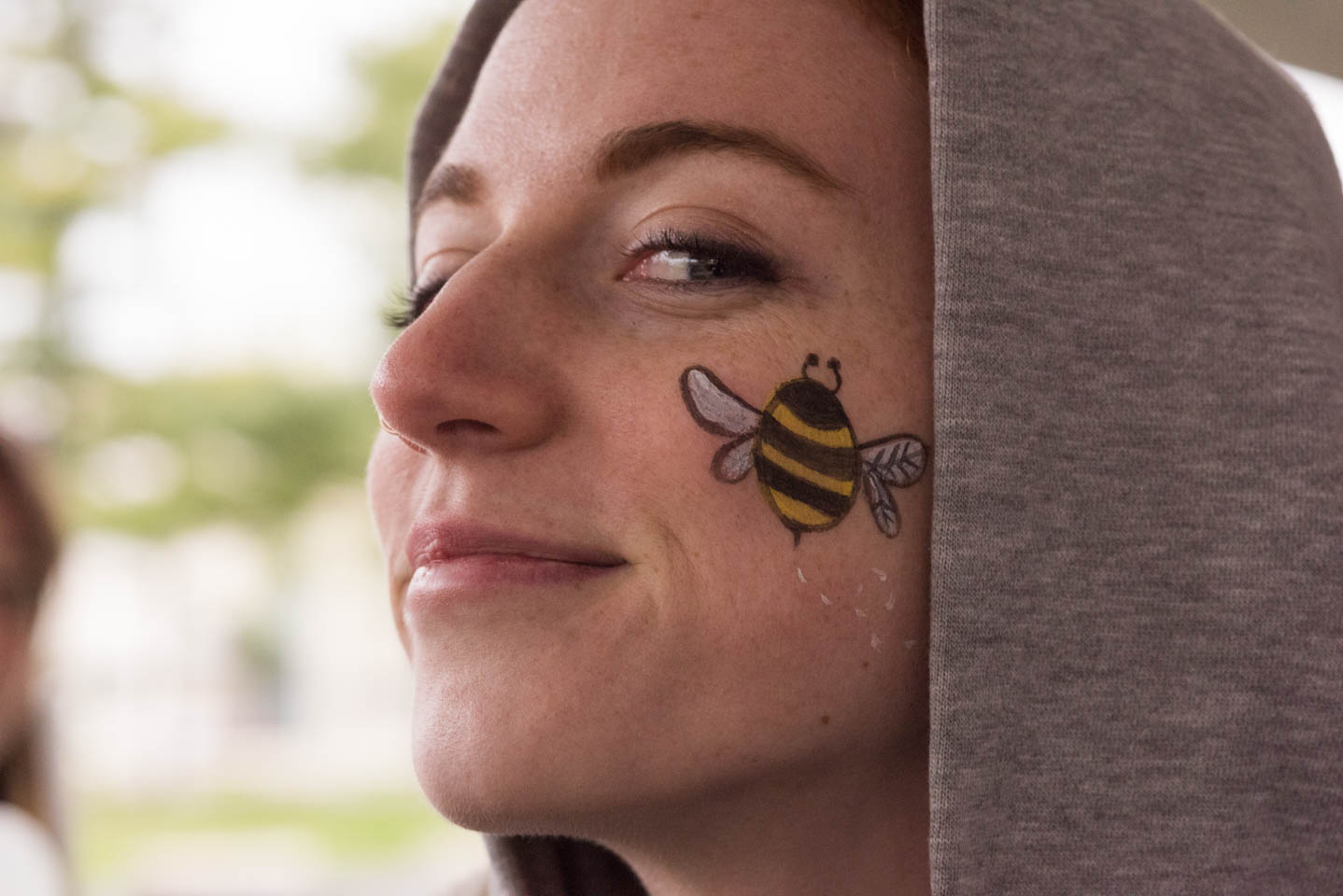 Caitlin Watters and bee face decoration